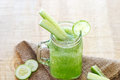 Cucumber smoothie diet, smoothie detox on sack and wooden backgr Royalty Free Stock Photo