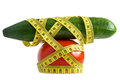 Cucumber tomato measuring tape and with over white the concept of dieting and health Stock Photography