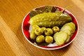 Cucumbers and olives Stock Photography