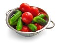 Cucumbers and tomatoes in steel bowl fresh on white background Royalty Free Stock Image