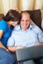 Cuddling with the laptop Royalty Free Stock Photography