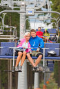 Cuddling young couple sitting chair lift pinewood Royalty Free Stock Photos