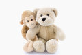 Cuddly animals hugging bear and monkey on white Royalty Free Stock Photo