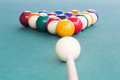 Cue aiming white ball to break snooker billards on table Royalty Free Stock Photo