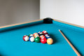 Cue and balls are on the table for billiard Stock Image
