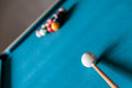 Cue and balls are on the table for billiard Stock Photo