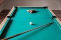Cue and balls on the table for billiard Stock Photos