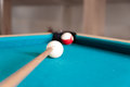 Cue strikes the cue ball close up Stock Photo