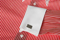 Cuff link on men's red shirt