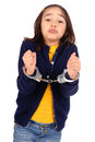 Cuffed little girl isolated in white Royalty Free Stock Photography