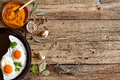 Culinary background with herbs and fried eggs Royalty Free Stock Photos