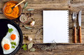 Culinary background with herbs and fried eggs Royalty Free Stock Images