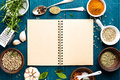 Culinary background and recipe book with spices on wooden table