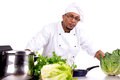 Culinary male chef with fruits and vegetables cooking Royalty Free Stock Images