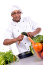 Culinary male chef with fruits and vegetables cooking Stock Photo