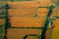 Cultivated farmland aerial view of with a mosaic of land and planted crops Royalty Free Stock Photography