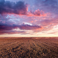 Cultivated land and cloud formations at sunset beautiful Stock Photo
