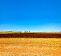Cultivated ploughed field in farm agriculture area Stock Photography