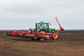 Cultivating tractor in the field. Royalty Free Stock Photo