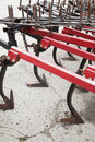 Cultivator hooks closeup of of plowing tractor Royalty Free Stock Photos