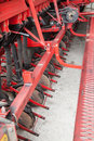 Cultivator machine knives of red plowing tractor Stock Photo