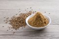 Cumin powder and seeds Royalty Free Stock Photo