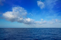 Cumulus clouds in blue sky over water horizon Royalty Free Stock Photos