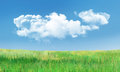Cumulus Clouds and Grass Landscape Stock Photography