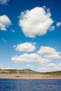 Cumulus Clouds over Lake Royalty Free Stock Photo
