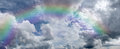 Cumulus clouds rainbow Royalty Free Stock Image