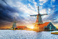 Cumulus clouds on sunset over dutch windmills in Rotterdam. Neth Royalty Free Stock Photo