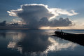 Cumulus clouds and sunset the silhouettes a massive cloud in the republic of palau micronesia this area is a popular destination Stock Photo