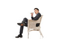 Cunning businessman of asian sit on chair Stock Photos