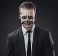 Cunning businessman with a makeup of the skeleton make up Stock Photos