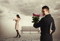 Cunning man going to metting men and holding flowers and knife Royalty Free Stock Photography