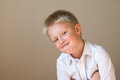 Cunning sly boy smiling happy smart child on gray background Stock Photos