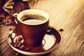 Cup of aromatic coffee over wooden table close up Royalty Free Stock Photo