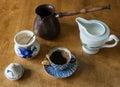 Cup of black coffee, cezve, milk jug Royalty Free Stock Photo