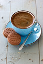 A cup of black coffee and chocolate biscuits on the wooden surface Royalty Free Stock Image