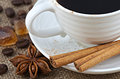 Cup of black coffee close up small white porcelain hot brewed turkish caramel brown sugar crystals cinnamon star anise home cookie Royalty Free Stock Image