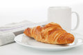 Cup of black coffee, croissants and newspaper Royalty Free Stock Photo