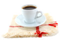 Cup of black coffee on a fabric napkin cloth white background Royalty Free Stock Image