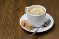 Cup of black coffee with foam and cane sugar cubes horizontal close up Stock Photo
