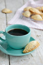 Cup of black coffee and fresh bakery little sweet pies Stock Photo