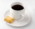 Cup of black coffee isolated with biscuit on background Stock Images