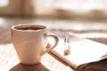 Cup of black coffee, newspaper and a pen Royalty Free Stock Photo
