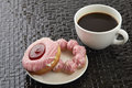 Cup of black coffee with pink donuts Royalty Free Stock Photo
