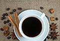 Cup of black coffee small white porcelain hot brewed turkish caramel brown sugar crystals cinnamon star anise home cookie and Stock Photos