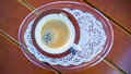 Cup of black coffee top view a presented on a lace pattern doily Royalty Free Stock Images