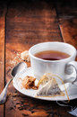 Cup of black tea and cookie time on wooden table Royalty Free Stock Image